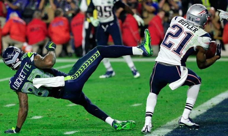 El novato Darius Butler interceptando a Russell Wilson a falta de veinte segundos para el final. Su acción dio la victoria a los Patriots.